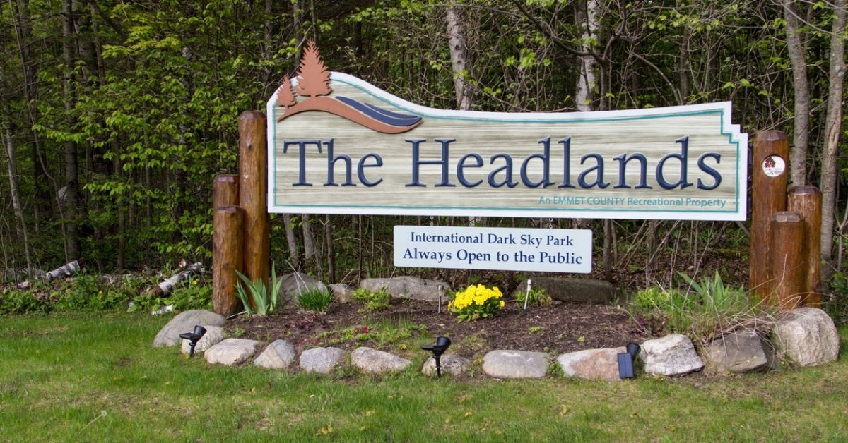 the headland park sign in front of park in michigan