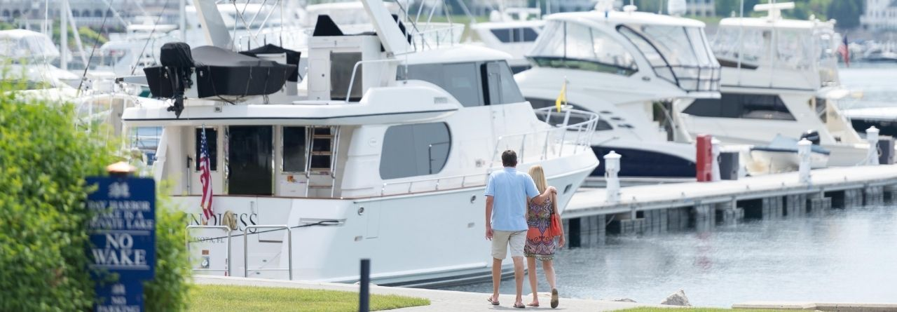 picture of couple walking along dock of bay harbor
